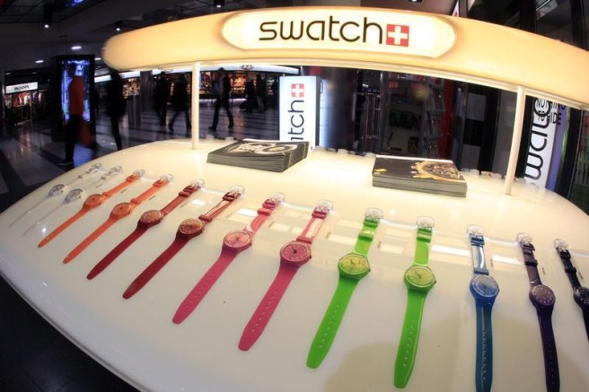 Swatch watches are displayed in front of a shop at the central station in Zurich